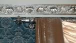 Detail zdobení lišty a záclonové konzole v jednotném stylu