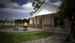 Součástí projektu je dům pro hosty.